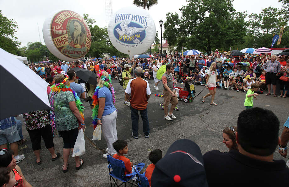 Balloons from Guenther & Son, C.H. are seen by the crowd at the King William Fair Parade on Saturday, Apr. 27, 2013. Photo: Kin Man Hui, Express-News / © 2013 San Antonio Express-News