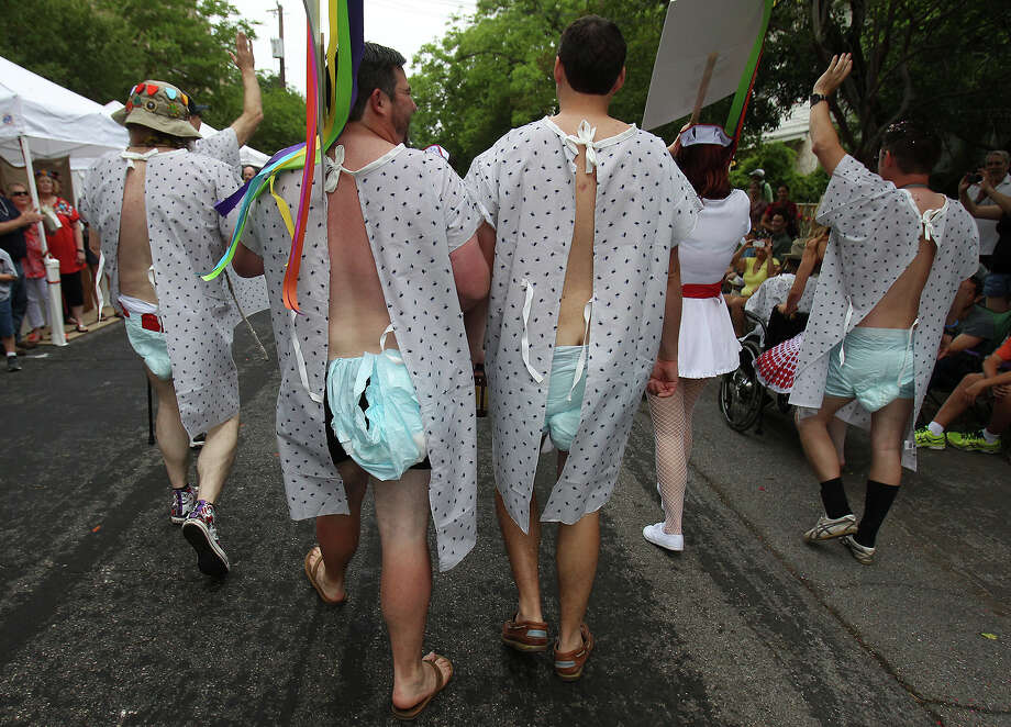 Diaper-wearing individuals stroll in the parade as part of the La Tuna group at the King William Fair Parade on Saturday, Apr. 27, 2013. Photo: Kin Man Hui, Express-News / © 2013 San Antonio Express-News