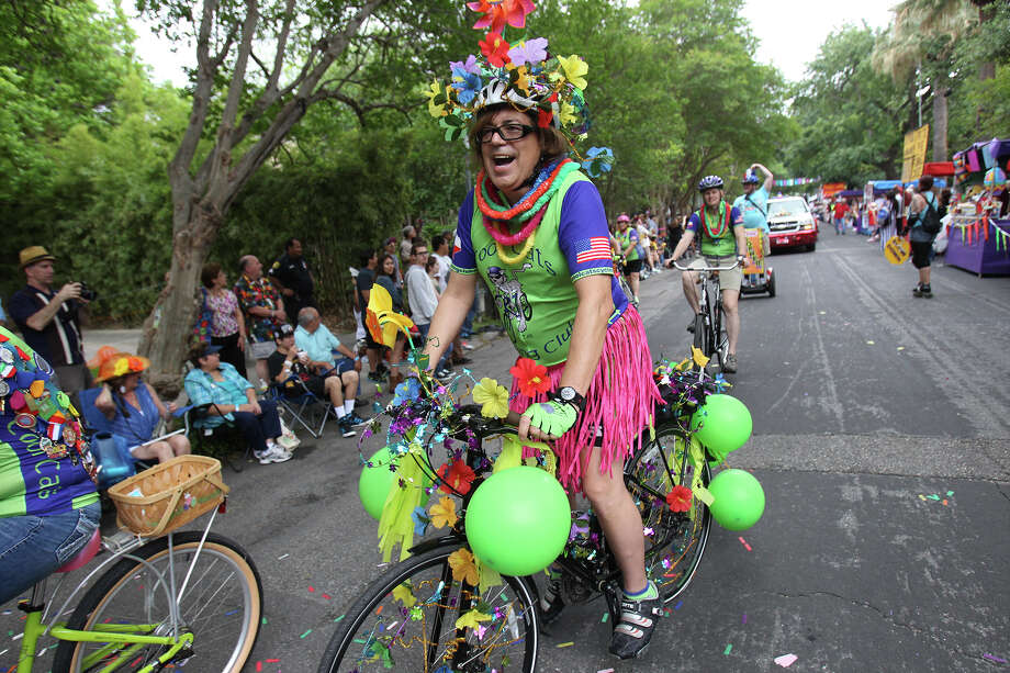 John Martinez decorates himself and his bike as he takes part in the King William Fair Parade on Saturday, Apr. 27, 2013. Photo: Kin Man Hui, Express-News / © 2013 San Antonio Express-News