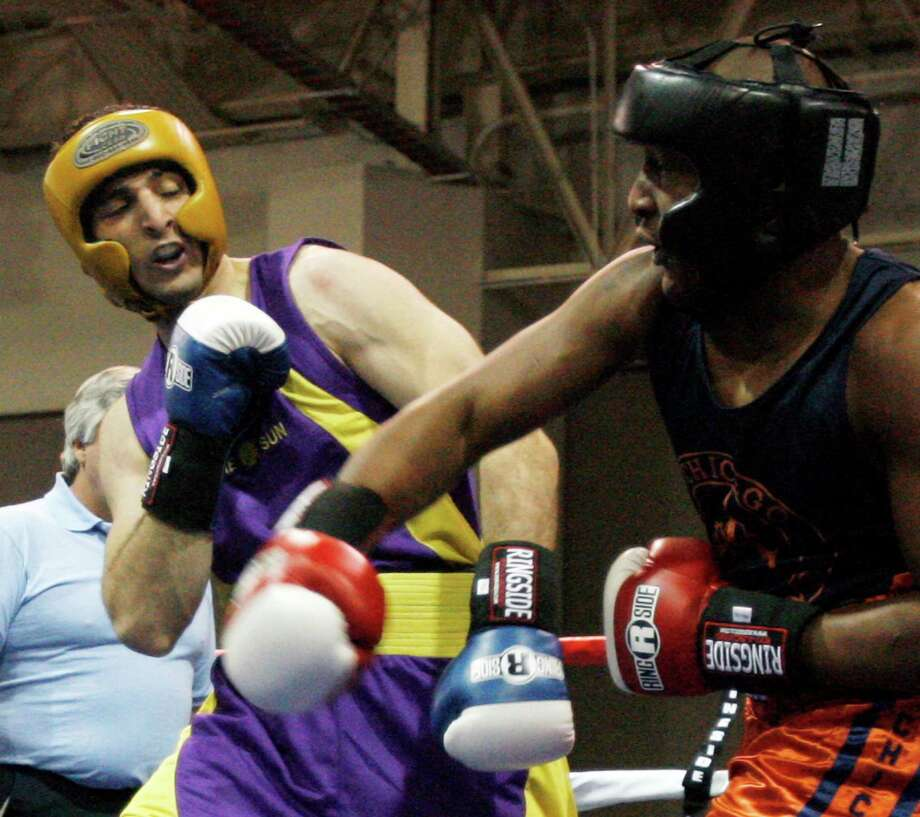 Tamerlan Tsarnaev, left, had success as a Golden Gloves fighter after coming to the U.S. Being denied a ring career may have changed his attitude toward the U.S. Photo: RICK EGAN, MBI / The Salt Lake Tribune