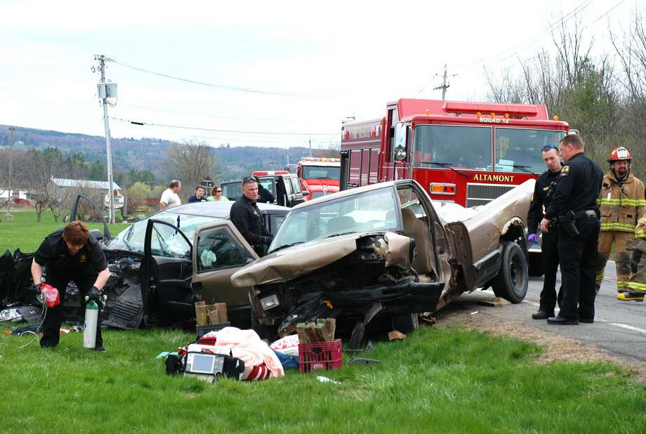 Authorities respond to the scene of a crash in Altamont on Saturday. At least one person was taken to the hospital. (Thomas Heffernan Sr./Special to the Times Union) Photo: Picasa