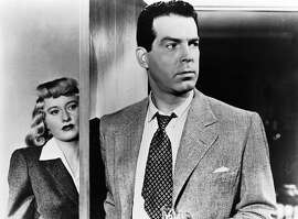 "This undated publicity photo,provided by Universal Studios Home Entertainment, shows actors Fred MacMurray and Barbara Stanwyck in the 1944 noir film ""Double Indemnity.""  The movie was released on DVD, in a two-disc version, in August 2006. (AP Photo/Universal Studios Home Entertainment)"