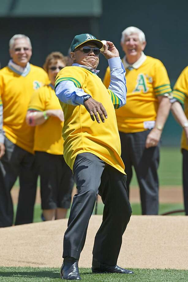 OAKLAND, CA - APRIL 27: Hall of Fame baseball player Reggie Jackson throws out the ceremonial first pitch following a ceremony honoring the 1973 world series championship before the game between the Oakland Athletics and the Baltimore Orioles at O.co Coliseum on April 27, 2013 in Oakland, California. (Photo by Jason O. Watson/Getty Images) Photo: Jason O. Watson, Getty Images