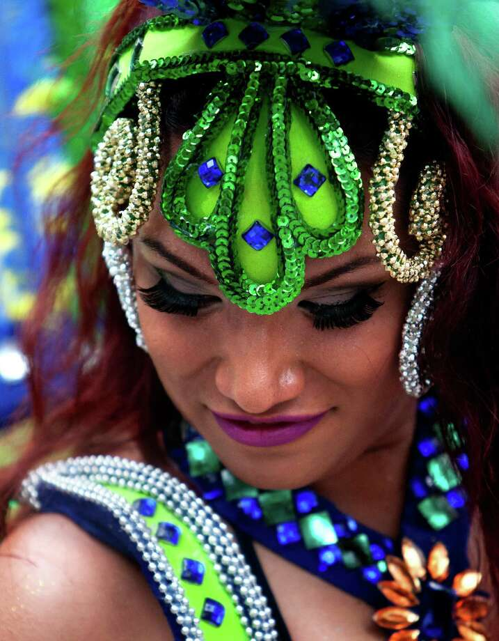 Dressed in customary carnival costumes, Brazilian Samba dancer Kanosky Munoz, dances in front of a crowd at the 2013 Houston International Festival, Saturday, April 27, 2013, in Houston. Photo: Cody Duty, Houston Chronicle / © 2013 Houston Chronicle