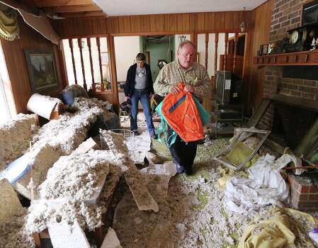 Dr. George Smith walks through his home with longtime friend Daniela Ranzinget (left) on Saturday. The house is in Zone 3, which is the most damaged area of West. Photo: Rod Aydelotte, Waco Tribune Herald