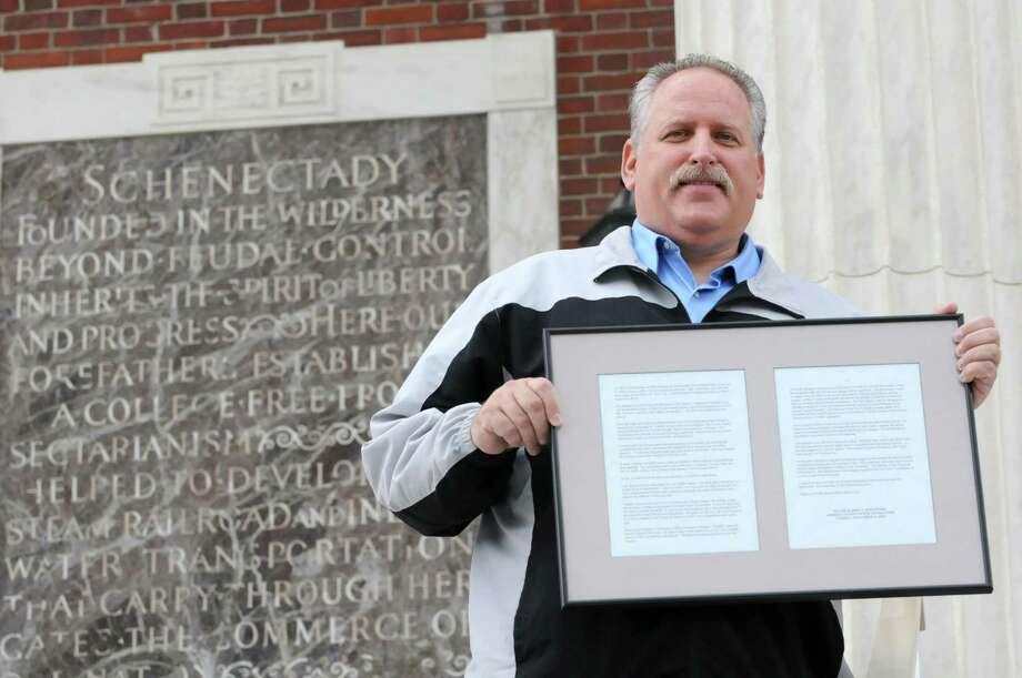 Former Schenectady mayor Al Jurczynski holds a framed copy of a speech he made to the county legislators on the day of November 12, 1996 on Wednesday, April 24, 2013 in Schenectady, N.Y. (Lori Van Buren / Times Union) Photo: Lori Van Buren / 10022141A