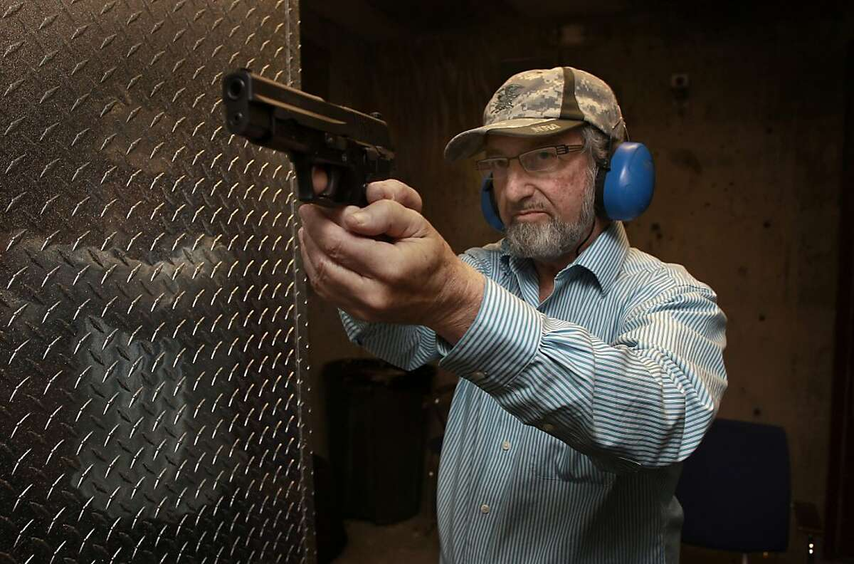 Local gun owner Jeff Levinger, demonstrates a shooting position as he aims his unloaded 9mm pistol while taking target practice at the Jackson Arms shooting range in South San Francisco, Calif., on Saturday April 27, 2013. A court case currently before the Ninth Circuit could drastically change the way concealed weapons permits are issued in California. Gun owners are hoping it will be easier to get permits and possibly increase the number of permits from 35,000 now to 1.2 million statewide within four years.