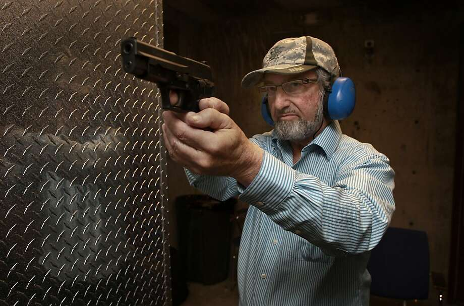 Local gun owner Jeff Levinger, demonstrates a shooting position as he aims his unloaded 9mm pistol while taking target practice at the Jackson Arms shooting range in South San Francisco, Calif., on Saturday April 27, 2013. A court case currently before the Ninth Circuit could drastically change the way concealed weapons permits are issued in California. Gun owners are hoping it will be easier to get permits and possibly increase the number of permits from 35,000 now to 1.2 million statewide within four years. Photo: Michael Macor, The Chronicle