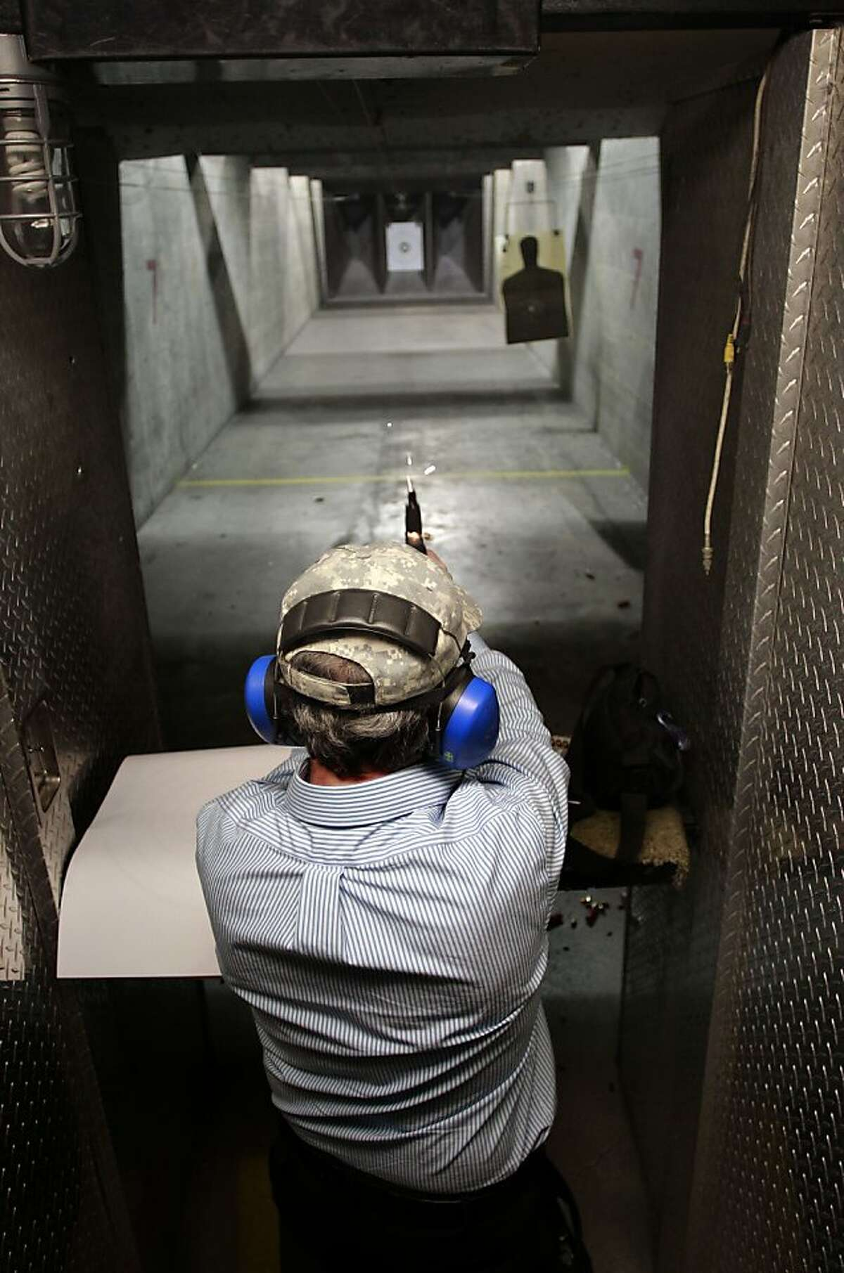 Local gun owner Jeff Levinger, fires his 9mm pistol while taking target practice at the Jackson Arms shooting range in South San Francisco, Calif., on Saturday April 27, 2013. A court case currently before the Ninth Circuit could drastically change the way concealed weapons permits are issued in California. Gun owners are hoping it will be easier to get permits and possibly increase the number of permits from 35,000 now to 1.2 million statewide within four years.
