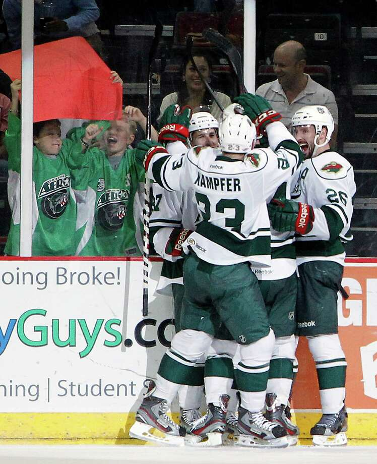 The Aeros and their fans behind the glass celebrate right wing Justin Fontaine's goal against Grand Rapids in the second period Friday night. Photo: Cody Duty, Staff / © 2013 Houston Chronicle