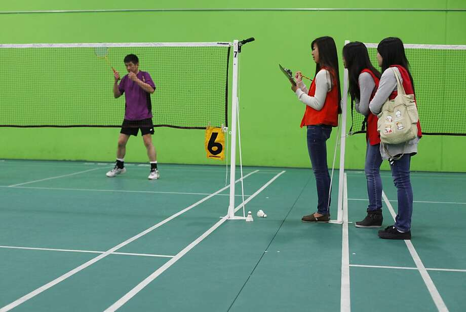 Scorekeepers Joanne Tu (left), Jasmine Tu and Jessica Ho at a badminton competition in the Bay Area Senior Games. Photo: James Tensuan, The Chronicle