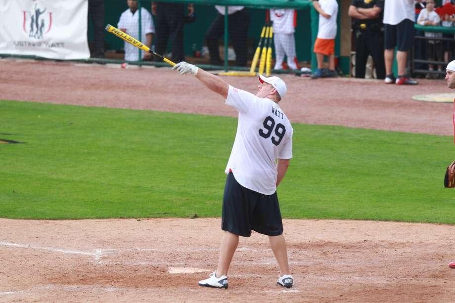 J.J. Watt calls out a home run during the first J.J. Watt Charity Classic at Constellation Field on Saturday, April 27, 2013, in Sugar Land. Photo: Mayra Beltran
