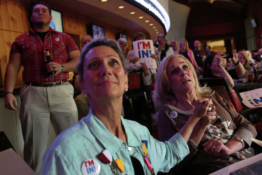 Lori Becknell, left, and Tammy Bookbinder, center, the wife of Russ Bookbinder, San Antonio Sports President and CEO, watch and wait for the announcement by USA Swimming to find out if San Antonio will host the 2016 U.S. Olympic Trials-Swimming  at the High Velocity Sports Bar at the JW Marriott San Antonio on Saturday, April 27, 2013. Photo: Lisa Krantz, Express-News / Lisa Krantz