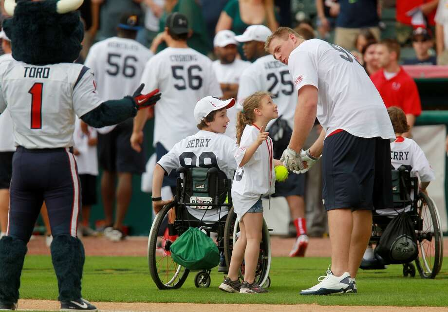 The Berry siblings all threw the opening pitch at the start of  the first J.J. Watt Charity Classic. Photo: Mayra Beltran