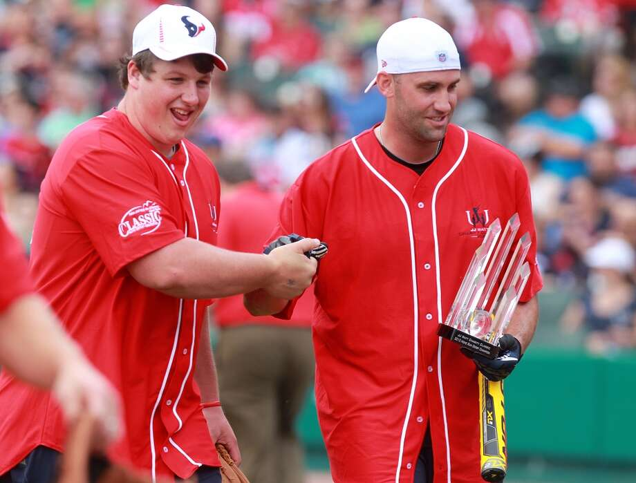 Ben Jones congratulates Matt Schaub for winning the Ker & Downey Home Run Derby. Photo: Mayra Beltran