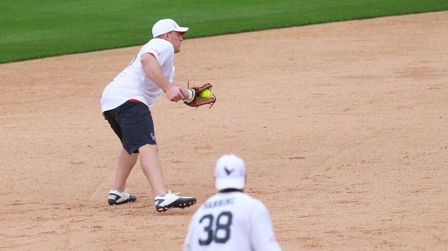 J.J. Watt fields a ball at shortstop. Photo: Mayra Beltran