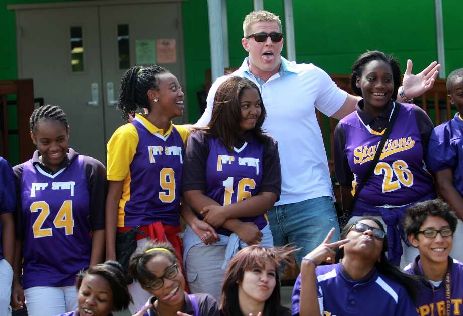 J.J. Watt joins in to pose for a funny photo with student athletes during his visit KIPP Spirit.  The J.J. Watt Foundation donates $60,000 for athletic equipment to KIPP Spirit and KIPP Liberation College Preparatory School. Photo: Mayra Beltran