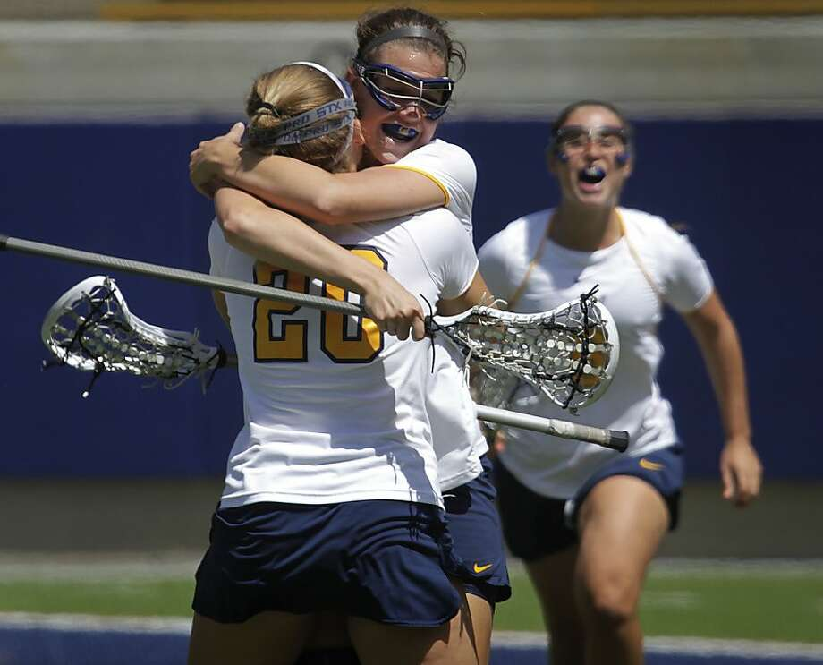 Megan Takacs celebrates a goal with Melissa Humphrey. Each scored three in Cal's last-minute loss. Photo: Paul Chinn, The Chronicle