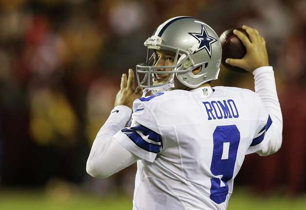 "(FILE) Tony Romo #9 of the Dallas Cowboys passes the ball during warm-ups prior to their game against the Washington Redskins at FedExField on December 30, 2012 in Landover, Maryland. Dallas star quarterback Tony Romo has reached on March 29, 2013 a six-year contract extension which would reportedly make him the highest paid player in Cowboys history. ""This is a significant day in terms of securing stability for our team for the future,"" Cowboys owner Jerry Jones said of the deal, which was reported by The Dallas Morning News to be worth $108 million with $55 million guaranteed.   AFP PHOTO/Getty Images/Rob CarrRob Carr/AFP/Getty Images Photo: ROB CARR, AFP/Getty Images / AFP ImageForum"