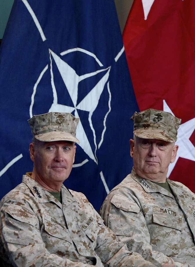 Gen. Joseph F. Dunford (left) assumed command of NATO forces in Afghanistan on Feb. 10 as the coalition prepares to withdraw the bulk of its combat troops by next year. Photo: Massoud Hossaini / Getty Images