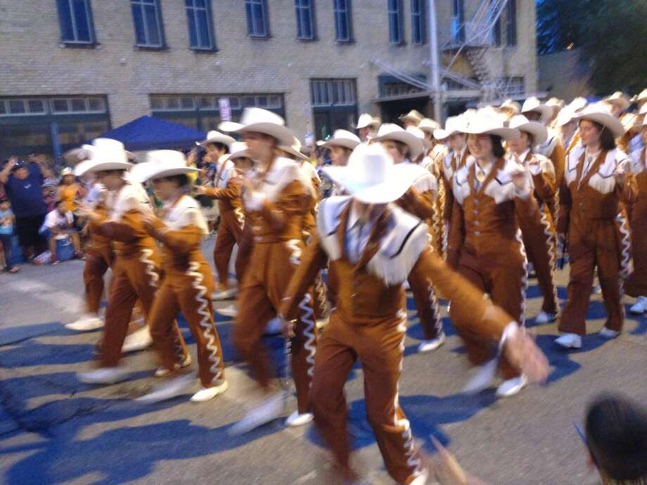 The University of Texas Longhorn Band at the Fiesta Flambeau Parade on Saturday night, April 27, 2013.