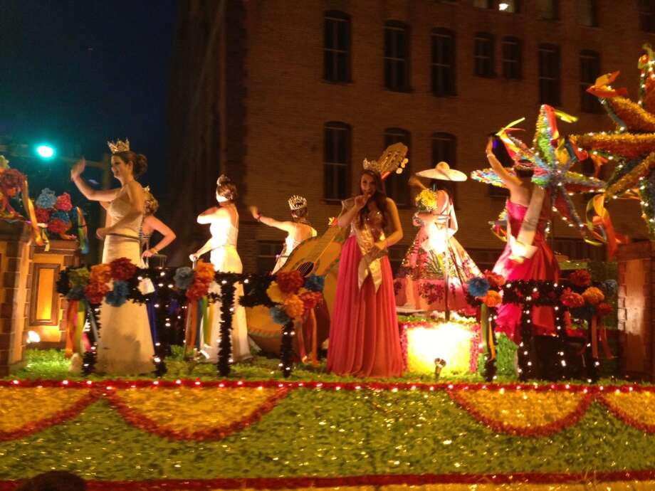 Fiesta queens at  the Flambeau Parade on Saturday night, April 27, 2013.