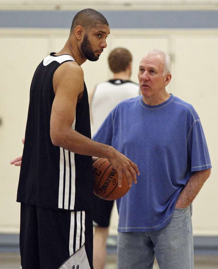 San Antonio Spurs' Tim Duncan talks with San Antonio Spurs head coach Gregg Popovich during practice Saturday April 27, 2013 at Santa Monica College in Santa Monica, CA.