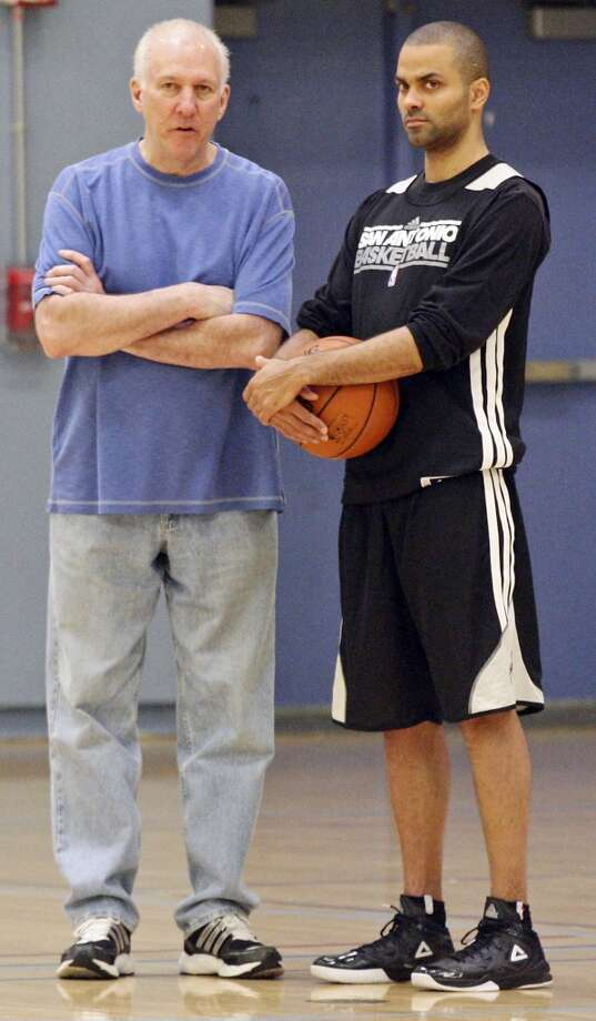San Antonio Spurs head coach Gregg Popovich talks with San Antonio Spurs' Tony Parker during practice Saturday April 27, 2013 at Santa Monica College in Santa Monica, CA.