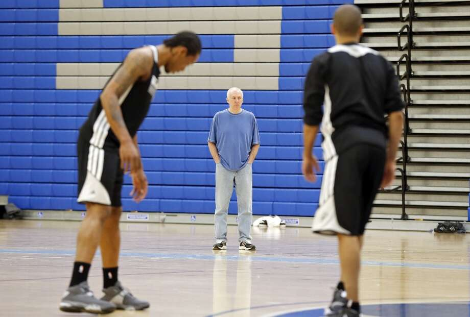 San Antonio Spurs head coach Gregg Popovich watches the team during practice Saturday April 27, 2013 at Santa Monica College in Santa Monica, CA.