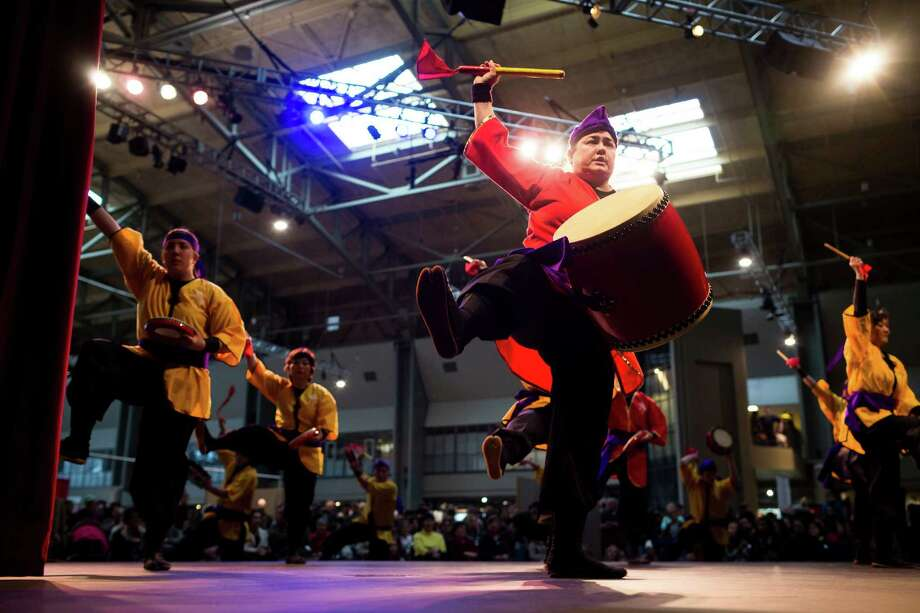 Susan Goudy, center right, performs with her musical troupe at the 38th annual Cherry Blossom and Japanese Cultural Festival Saturday, April 27, 2013, at The Armory in Seattle. The festival boasted over 60 traditional performing arts and craft stations, drawing acts from as far away as Okinawa, Japan. Photo: JORDAN STEAD, SEATTLEPI.COM / SEATTLEPI.COM