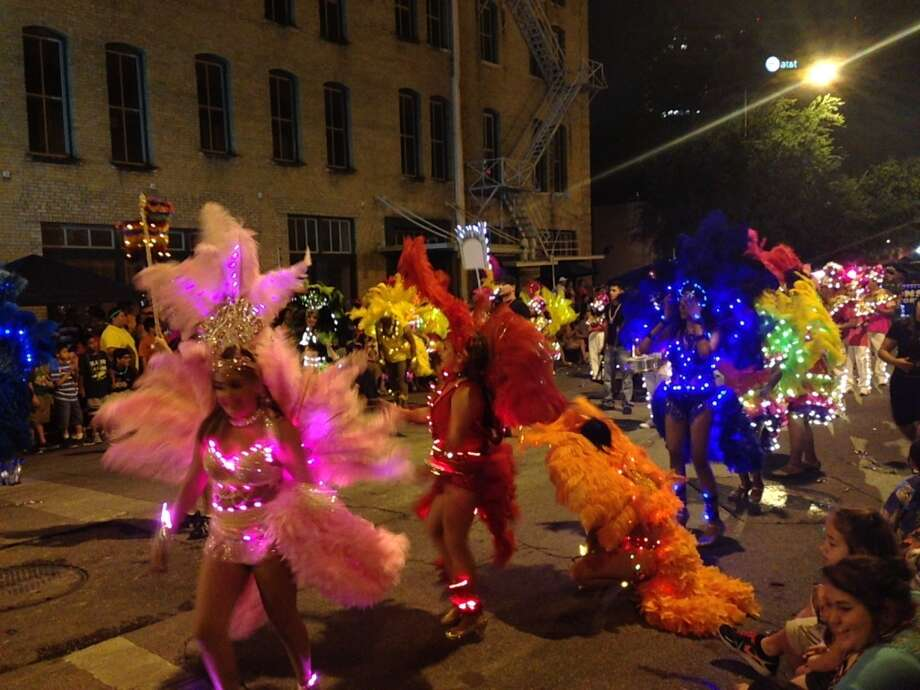 Dancers at the Fiesta Flambeau Parade on Saturday night, April 27, 2013.