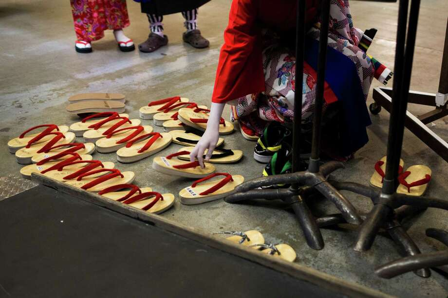 Sandals, traditionally abandoned by their owners before a performance, sit at the edge of the stage during the 38th annual Cherry Blossom and Japanese Cultural Festival Saturday, April 27, 2013, at The Armory in Seattle. The festival boasted over 60 traditional performing arts and craft stations, drawing acts from as far away as Okinawa, Japan. Photo: JORDAN STEAD, SEATTLEPI.COM / SEATTLEPI.COM