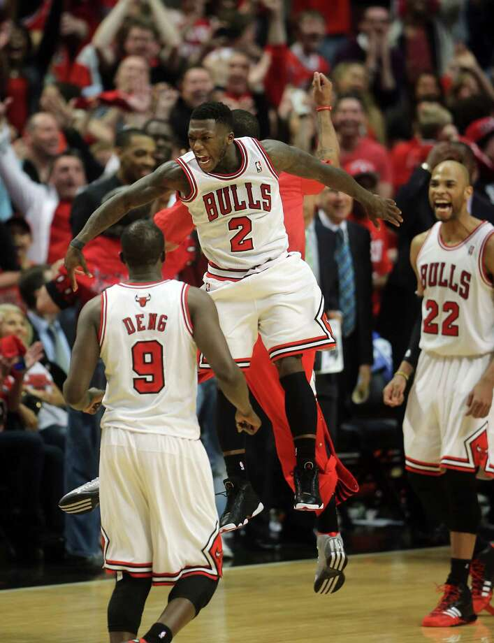 Bulls guard Nate Robinson had plenty of reasons to celebrate after he scored 34 points to help the Bulls erase a 14-point deficit in a win over the Nets. Photo: Brian Cassella, MBR / Chicago Tribune