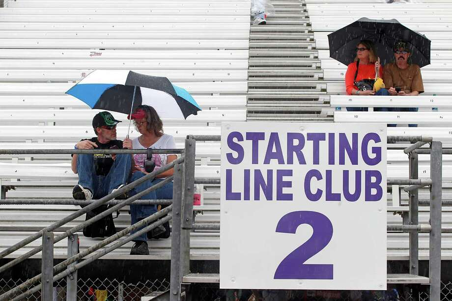 4/27/13: Race fans wait during a rain delay on the second day of qualifying at Royal Purple Speedway in Baytown, Texas. Photo: Thomas B. Shea, For The Chronicle / © 2013 Thomas B. Shea