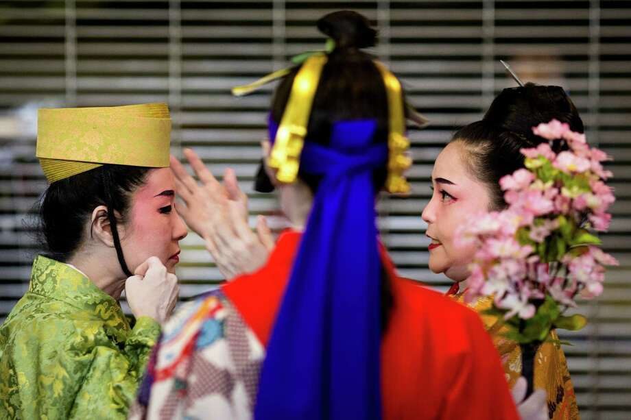 Moments before taking the stage, performers secure headdresses at the 38th annual Cherry Blossom and Japanese Cultural Festival Saturday, April 27, 2013, at The Armory in Seattle. The festival boasted over 60 traditional performing arts and craft stations, drawing acts from as far away as Okinawa, Japan. Photo: JORDAN STEAD, SEATTLEPI.COM / SEATTLEPI.COM