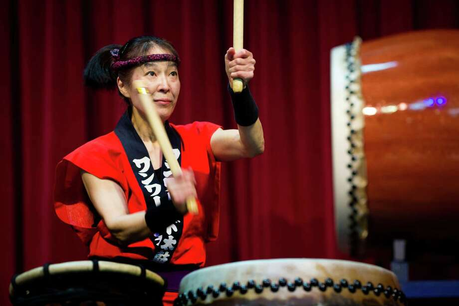 Nancy Ozaki, of One World Taiko, performs at the 38th annual Cherry Blossom and Japanese Cultural Festival Saturday, April 27, 2013, at The Armory in Seattle. The festival boasted over 60 traditional performing arts and craft stations, drawing acts from as far away as Okinawa, Japan. Photo: JORDAN STEAD, SEATTLEPI.COM / SEATTLEPI.COM