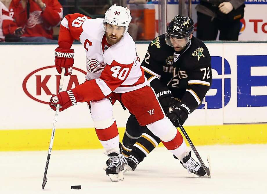 DALLAS, TX - APRIL 27:  Henrik Zetterberg #40 of the Detroit Red Wings skates the puck against Erik Cole #72 of the Dallas Stars at American Airlines Center on April 27, 2013 in Dallas, Texas.  (Photo by Ronald Martinez/Getty Images) Photo: Ronald Martinez, Getty Images