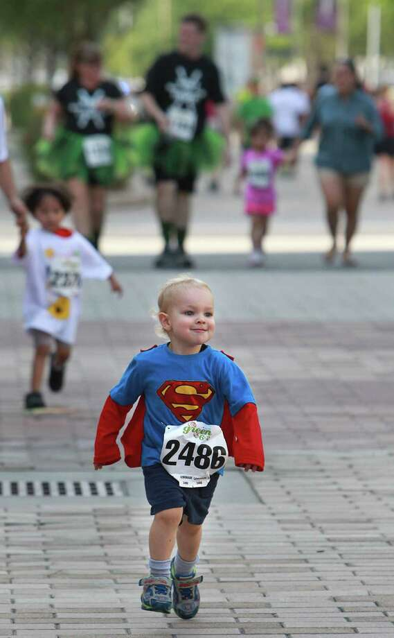 Oliver Jackson, 2, crosses the finish line as he runs toward his mother Meg Jackson in the Lemonade Day Kids 1K Fun Run at City Center on Saturday, April 27, 2013, in Houston. Photo: Mayra Beltran / © 2013 Houston Chronicle