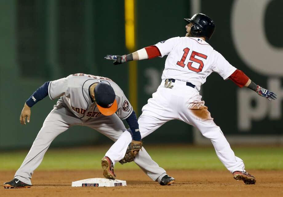 Marwin Gonzalez, left, holds onto Dustin Pedroia (15) after Pedroia stole second. Photo: Michael Dwyer, Associated Press