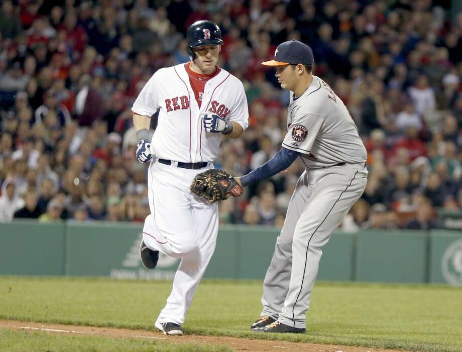 Brandon Laird, right, tags out Stephen Drew on a ground out.