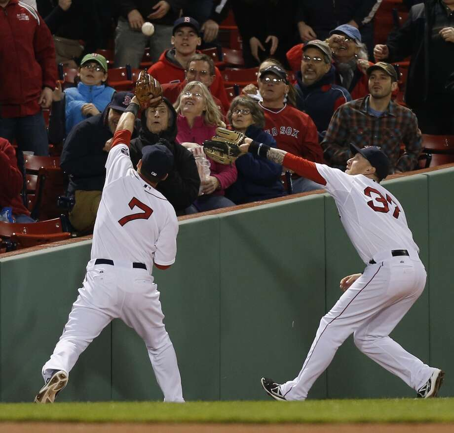 Stephen Drew (7) and Mike Carp (37) try to field a foul ball.