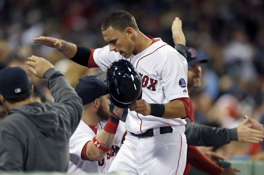 Will Middlebrooks celebrates after scoring in the second inning. Photo: Michael Dwyer, Associated Press