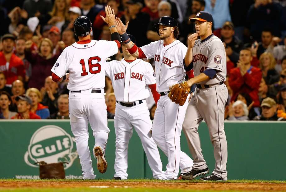 Will Middlebrooks #16 of the Red Sox is congratulated by teammate Jarrod Saltalamacchia #39 after both scored on a Jacoby Ellsbury hit.