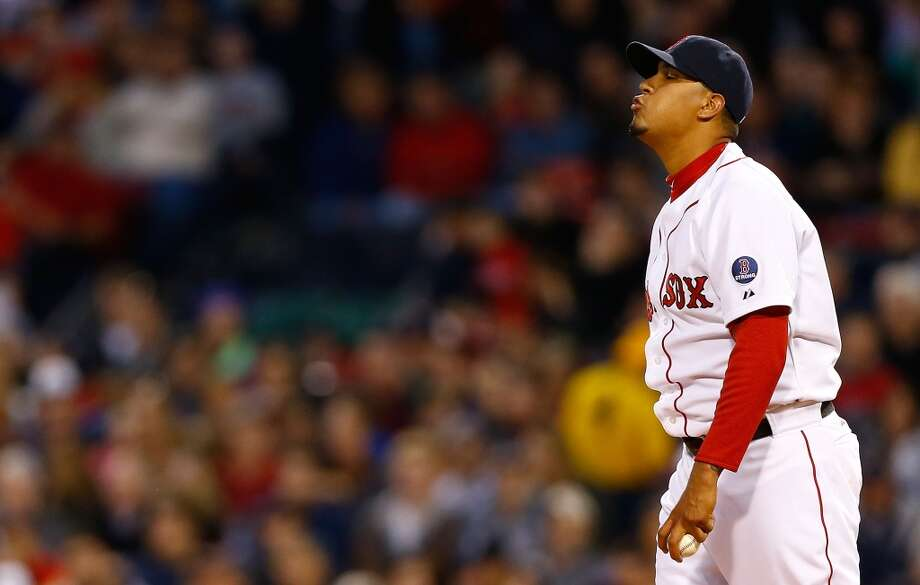 Felix Doubront #22 of the Red Sox reacts after giving up a hit.