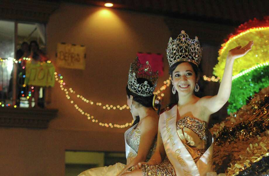 """Borderfest Queen Samantha Landeros waves during the annual Fiesta Flambeau Night Parade on Saturday, April 27, 2013. The theme of this year's parade was """"Celebrating San Antonio."""" Photo: Billy Calzada, San Antonio Express-News / © 2013 San Antonio Express-News"""