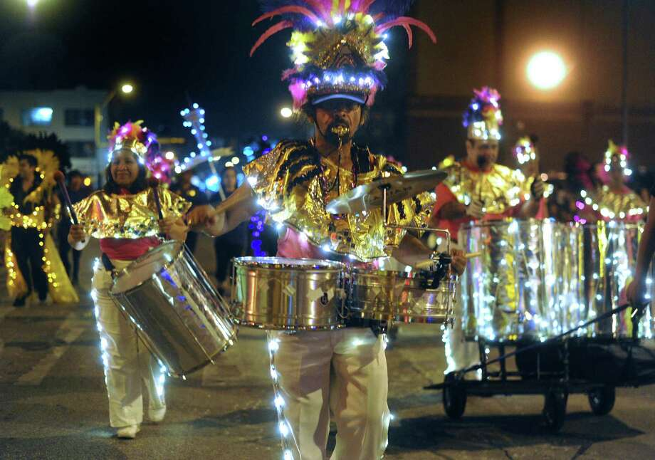 "The Samba Vida percussion section plays during the annual Fiesta Flambeau Night Parade on Saturday, April 27, 2013. The theme of this year's parade was ""Celebrating San Antonio."" Photo: Billy Calzada, San Antonio Express-News / © 2013 San Antonio Express-News"