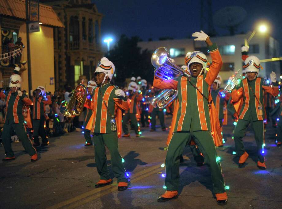 "The Sam Houston High School marching band performs during the annual Fiesta Flambeau Night Parade on Saturday, April 27, 2013. The them of this year's parade was ""Celebrating San Antonio."" Photo: Billy Calzada, San Antonio Express-News / © 2013 San Antonio Express-News"