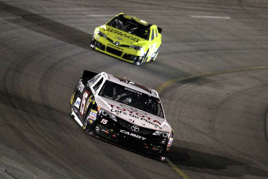 RICHMOND, VA - APRIL 27:  Clint Bowyer, driver of the #15 Toyota Care Toyota, leads Matt Kenseth, driver of the #20 Dollar General Toyota, during the NASCAR Sprint Cup Series Toyota Owners 400 at Richmond International Raceway on April 27, 2013 in Richmond, Virginia.  (Photo by Todd Warshaw/Getty Images) Photo: Todd Warshaw