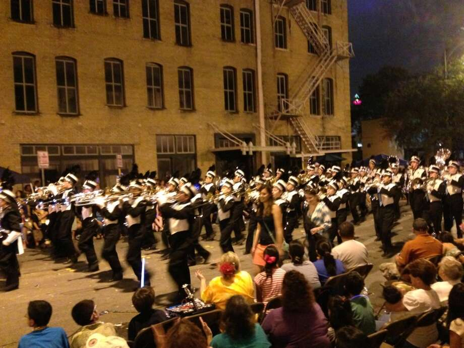 The Auburn High School marching band is seen at the Fiesta Flambeau Parade on Saturday night, April 27, 2013.