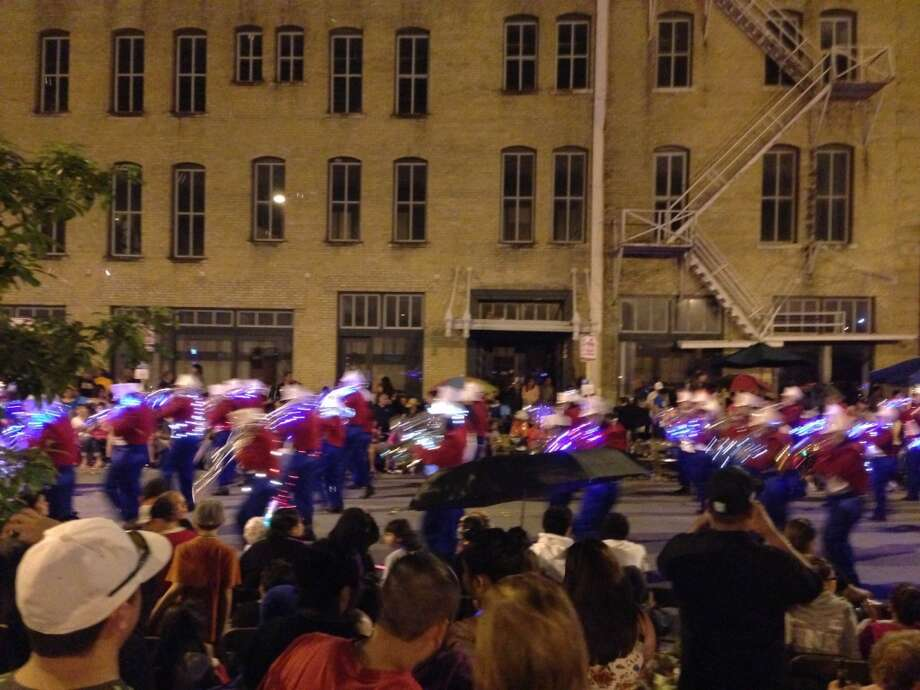 The Jefferson High School marching band is seen at the Fiesta Flambeau Parade on Saturday night, April 27, 2013.